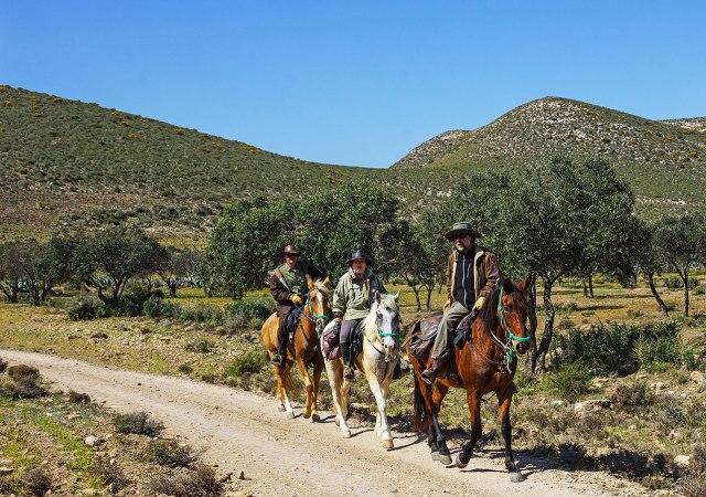 Riders passing Cortijo del Montana